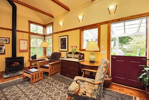 Craftsman Living Room with Wood Stove fireplace, Hardwood floors, Wainscotting, Crown molding, Standard height, Wall sconce