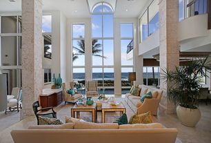 Tropical Living Room with Columns, Arched window, sandstone tile floors, Natural light, Cathedral ceiling