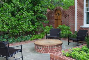 Traditional Patio with Arbor, six panel door, Raised beds, exterior stone floors, Fence, double-hung window
