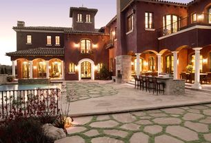 Mediterranean Patio with French doors, Deck Railing, exterior stone floors, Casement, Fence, Outdoor kitchen