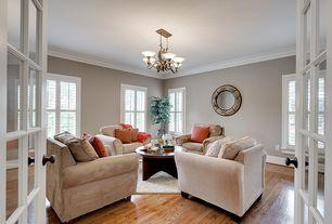 Traditional Living Room with French doors, Casement, Paint 1, Hardwood floors, Crown molding, Chandelier, Standard height