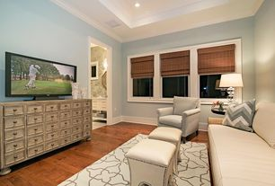 Contemporary Living Room with Crown molding, Hardwood floors