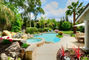Tropical Swimming Pool with Raised beds, Pathway, Pool with hot tub, exterior tile floors, Fence