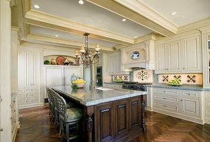 Traditional Kitchen with Wall Hood, Chandelier, Framed Partial Panel, full backsplash, Standard height, gas range, wall oven