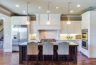Traditional Kitchen with Stone Tile, full backsplash, Standard height, can lights, Inset cabinets, Paint, Breakfast bar
