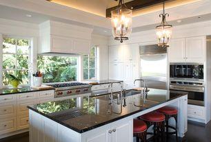 "Traditional Kitchen with Raised panel, Wolfe - 36"" dual fuel range - 6 burners, High ceiling, Custom hood, Pendant light"