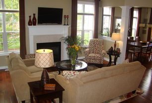 Traditional Living Room with Columns, Hardwood floors, stone fireplace