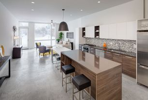 Contemporary Great Room with Polished Concrete Flooring, French doors, Concrete floors, Pendant light, Built-in bookshelf