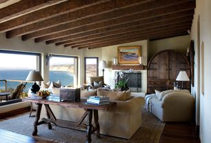 Eclectic Living Room with Exposed beam, Hardwood floors, Wall sconce, metal fireplace