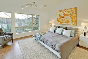 Contemporary Master Bedroom with Pendant light, Hardwood floors, Cathedral ceiling, Built-in bookshelf