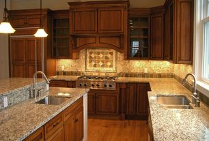 Craftsman Kitchen with Pental  Gold Antique Polished Granite, Glass panel, L-shaped, Ceramic Tile, Slate Tile, Custom hood