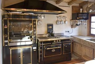 Rustic Kitchen with penny tile floors, double oven range, Simple granite counters, Exposed beam, Paint 1, Flush, Wall Hood