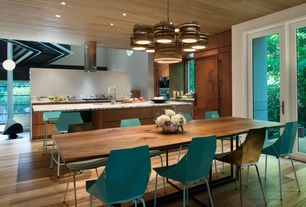 Modern Dining Room with Hardwood floors, specialty window, can lights, French doors, Standard height, Columns, Chandelier