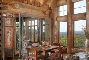 Rustic Dining Room with Exposed beam, Hardwood floors, Rugs direct 10' x 13' rectangular oriental weavers tones 5444j