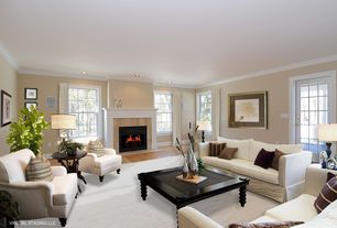 Traditional Living Room with Crown molding, Hardwood floors, stone fireplace, French doors