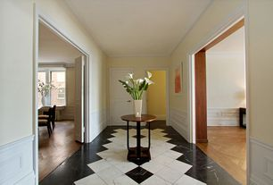 Traditional Entryway with Chair rail, Concrete tile , Crown molding, Wainscotting, specialty door