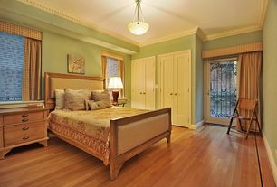 Guest Bedroom with French doors, Hardwood floors, Crown molding, Built-in bookshelf, flush light