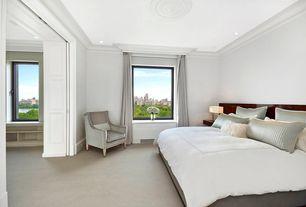 Traditional Master Bedroom with Window seat, Carpet, Crown molding, specialty door
