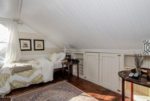 Cottage Guest Bedroom with Threshold trellis print lamp shade, Hardwood floors, Built-in bookshelf, paint2