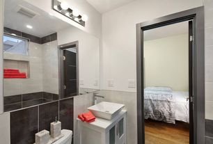 Contemporary Full Bathroom with wall-mounted above mirror bathroom light, Vessel sink, can lights, Full Bath, Casement, Flush