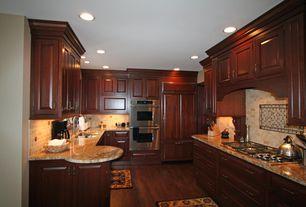 Traditional Kitchen with Raised panel, specialty door, Complex granite counters, U-shaped, Hardwood floors, Custom hood