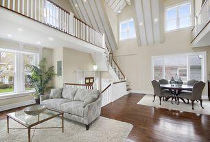 Traditional Dining Room with Dark walnut ash veneer 48-inch dining table, Hardwood floors, Loft, High ceiling