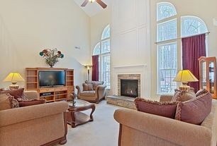 Traditional Living Room with Carpet, stone fireplace, Ceiling fan, High ceiling