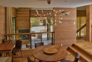 Contemporary Dining Room with Loft, Hardwood floors, Standard height, Chandelier, can lights