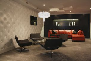 Contemporary Basement with Modern Curved Swivel Chair in Gray, tv wall mount, Chandelier, Carpet, Standard height, can lights