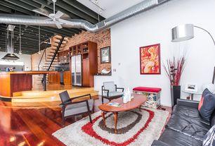 Modern Great Room with High ceiling, Exposed beam, Hardwood floors, Ceiling fan, Sunken living room, Pendant light