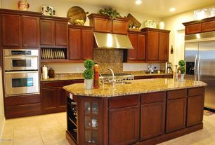 Traditional Kitchen with double wall oven, partial backsplash, Simple Granite, Framed Partial Panel, double oven range