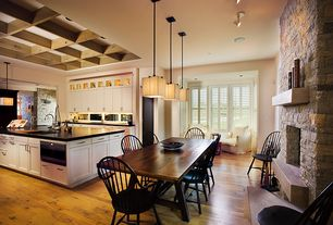 Country Dining Room with Hardwood floors, Pottery barn benchwright extending dining table, Pendant light, stone fireplace