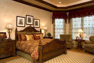 Mediterranean Master Bedroom with Crown molding, High ceiling, Hardwood floors
