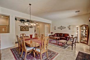 Traditional Dining Room with Standard height, Chandelier, sandstone tile floors, stone tile floors