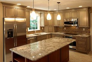 Traditional Kitchen with Undermount sink, full backsplash, Complex granite counters, limestone tile floors, can lights, Flush