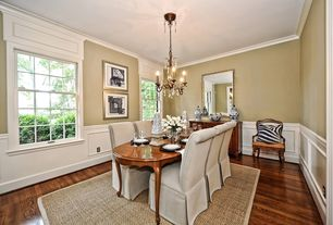 Traditional Dining Room with double-hung window, Hardwood floors, Crown molding, Chandelier, Wainscotting, Chair rail, Paint