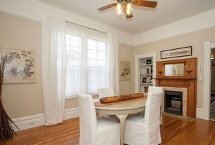 Traditional Dining Room with Built-in bookshelf, Hardwood floors, stone fireplace, Ceiling fan
