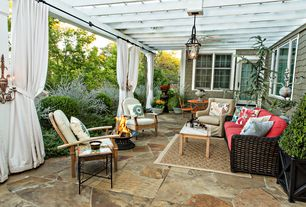Traditional Patio with French doors, Trellis, Lisbon Resin Wicker Sofa with Corded Cushions and Throw Pillows