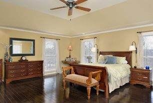 Traditional Master Bedroom with Built-in bookshelf, Crown molding, Ceiling fan, Hardwood floors