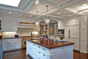 Traditional Kitchen with Pendant light, Complex Marble Tile, Breakfast bar, U-shaped, Skylight, Wainscotting, Custom hood