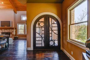 Eclectic Entryway with French doors, Standard height, Hardwood floors, double-hung window