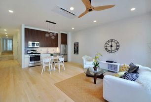 Contemporary Living Room with Hardwood floors, Ceiling fan