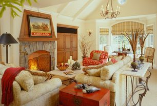 Traditional Living Room with Built-in bookshelf, Chandelier, High ceiling, Wall sconce, Crown molding, Carpet, Exposed beam
