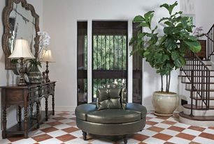 Traditional Entryway with High ceiling, Glass panel door, terracotta tile floors, Built-in bookshelf