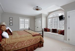 Traditional Master Bedroom with Custom Built-in Bench, An Italian Gilt Metal Sunburst Fixture, Paint1, Crown molding, Carpet