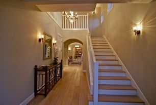 Traditional Staircase with High ceiling, picture window, Hardwood floors, Floating staircase, Wall sconce