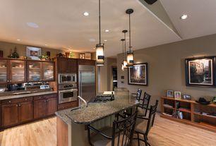 Craftsman Kitchen with Flat panel cabinets, Pendant light, Kitchen island, Breakfast bar, Glass panel, European Cabinets