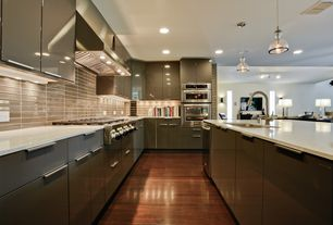 Contemporary Kitchen with Flush, Simple granite counters, European Cabinets, Pendant light, Subway Tile, U-shaped