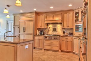 Traditional Kitchen with full backsplash, double wall oven, Sandstone Tile, Stone Tile, built-in microwave, stone tile floors