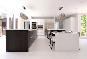 Contemporary Kitchen with Pendant light, Bernhardt Gustav Metal Side Chair, French doors, Corian counters, European Cabinets